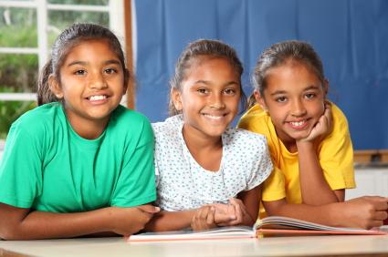 Three African School Girls Smiling